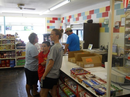 Customers were ample on Independence Day morning as manager Aaron Monihen assisted them at the newly refurbished, restocked, service-oriented Alta Vista Market.