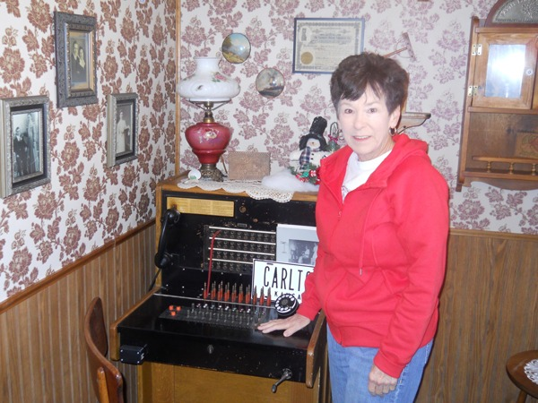 Serving as a telephone switchboard operator at her hometown community of Carlton while attending high school in Chapman where she graduated, Sandy (Martin) Browning has an antique telephone switchboard on display along with a small one room school in her Sandy's Country Store at the Circle B- near Emporia.