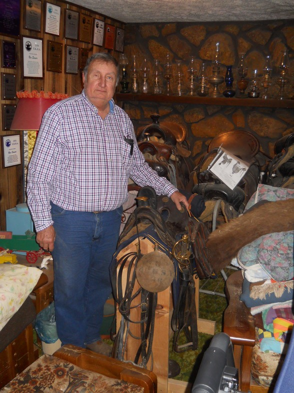 "With a collection of more than 150 saddles from nearly 150 years, Stan Seuser of Salina said, ""My favorite would have to be this Civil War officer's McClellan mule saddle. It is complete, blanket, bridle, bedroll, canteen, sword, scabbard, everything. I'd have to say I'm as proud of it as anything I have."" Many annual horse show awards line home display walls, too."