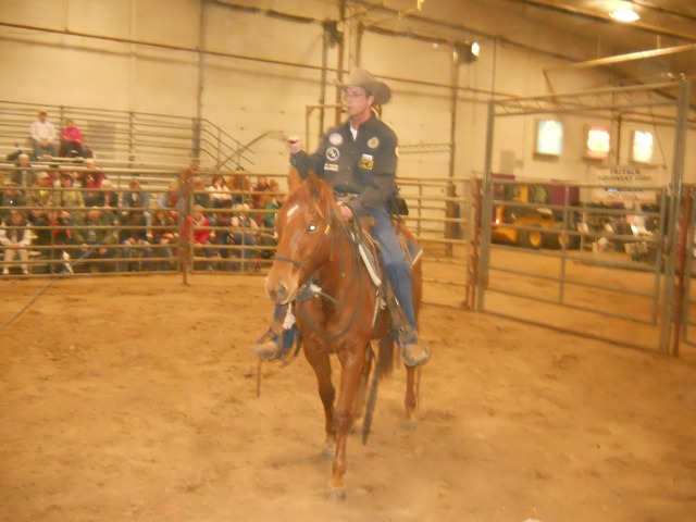 """""""Don't be scared,"""" Scott Daily calmed his mount as he popped a long black bullwhip all around her in a desensitizing process for the initially untrained sorrel filly used by the Arkansas City clinician in a horse handling seminar at the Topeka Farm Show."""