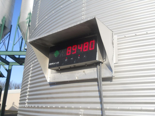 Digital scales screen verifies exact weight of truck and trailer filled with soybeans before it leaves Haselwood Farms, Inc., at Berryton for commercial shipment to terminal market. Although, payment is received on end weight, Bob Haselwood knows the exact pounds of grain leaving his farm.