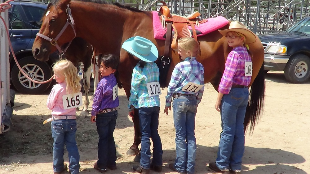 There's nothing like a horse to make a child happy as verified by these students of Diane Haffener at the D-Bar Arena near St. George.