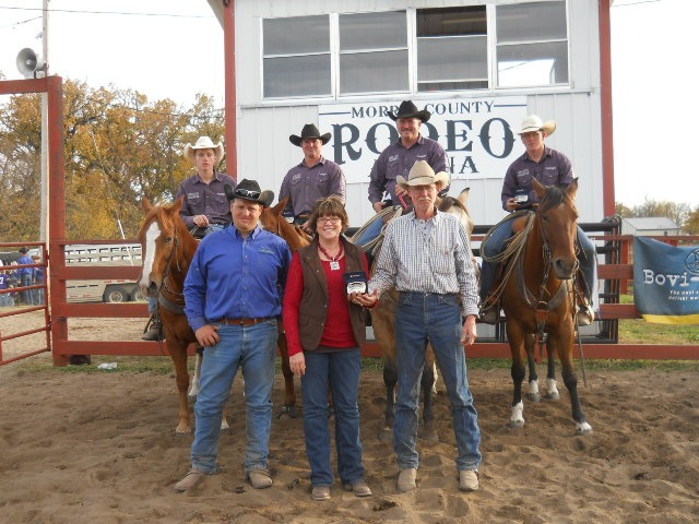 Jason Gibson, volunteer chairman of the fourth annual Thomas K. Reed Memorial Ranch Rodeo at Council Grove, presented a duplicate championship buckle to Mr. and Mrs. Ken Reed of the Reed Ranch at Allen in memory of their son who passed away in a ranching accident in 2009.