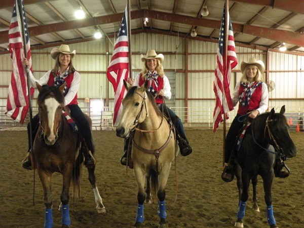 All decked out in their red, white and blue outfits, three members of the newly formed Kansas Pride and Glory Riders patriotic drill team practiced earlier this week for their debut performance at the Burlingame Rodeo, May 17-18. Left to right are: Amy Bermudez, Berryton; Bonnie Thorne, Wakarusa; and Lori Walker, Overbrook.