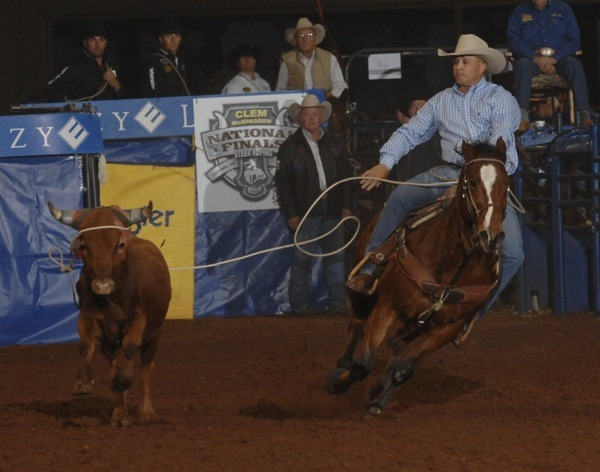 Rocky Patterson of Pratt shows the form that took him to his third world champion steer roper title at the National Finals Steer Roping in Guthrie, Oklahoma.