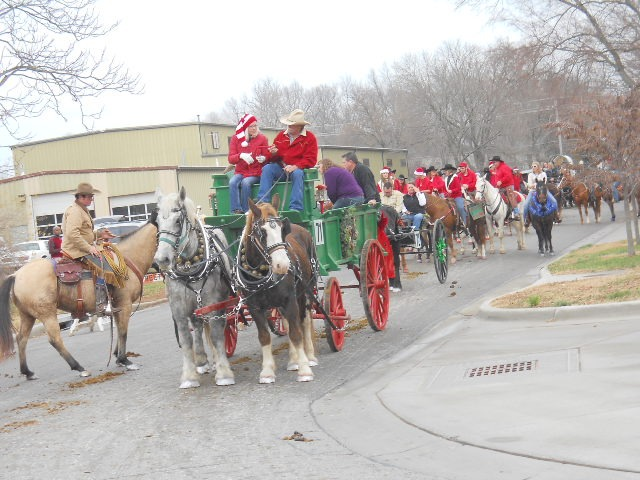 There were 113 entries in the 20th anniversary Lawrence Old-Fashioned Christmas parade as Number 71, Anna Lemmon of Lenexa, and other horseback riders and participates lined up before the 11 o'clock starting time.