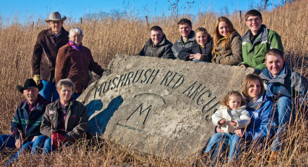 """As verified in this portrait when honored last year as """"Stockmen of the Year,"""" Mushrush Red Angus is a family operation in the Flint Hills of Kansas, headquartered at Elmdale. Bob and Oma Lou Mushrush, founders, are with son, Joe and wife Connie; children, Daniel, Casey and wife Ericka, Cole, Laura, Chris, Madelyn, Daniel and wife Christine, their children, Sadie and Isabella."""