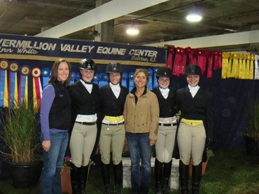 Ann White, head trainer at Vermillion Valley Equine Center, Belvue, is with a group of her students after a successful day in the show ring verified by the many award rosettes collected.
