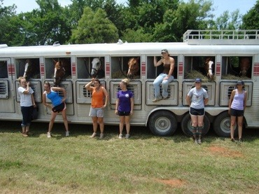 Eight horses are loaded in the Vermillion Valley Equine Center trailer as their riders get ready to hit the horseshow circui