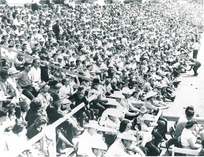 """""""No room to breathe,"""" somebody said, but there were no complaints as the action made all eyes peeled to the arena floor, as demanded  """"peanuts, popcorn, and pop,"""" kept the callers-peddlers more than busy with refills during this Sunday afternoon performance of the Flint Hills Rodeo in 1963. Evening shows for the 78th edition of the professional Western action is set for the same renowned Strong City arena June 4-5-6."""