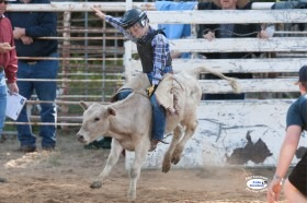 Proving his all-around ability, 10-year-old many-times junior rodeo champion cowboy Cash Fuesz, Eureka, scored 76 points to win second place in calf riding at a Heartland Youth Rodeo Association (HYRA) competition in Hutchinson. He ended the summer series as calf riding champion for his age group. (Photo ©Foto Cowboy.)