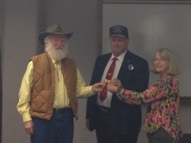 Representing Mulberry Meadows Ranch at Brookville, Boer goat breeders Art Howell, left, and Carol Ann Bachofer, right, were honored by the Kansas Meat Goat Association during a presentation by Fred Homeyer at the group's annual meeting.