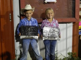 Dexton Hoelting, Olpe, and Taylor Gustafson, Junction City, were named all-around cowboy and cowgirl, respectively, in the junior division of the Morris County Youth Rodeo Saturday night at Council Grove. (Photo by Amy Allen.)