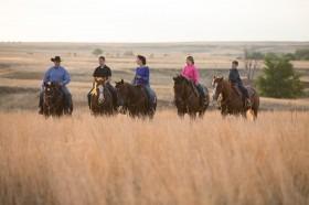 Horses are all in the family at Gardiner Quarter Horses as Garth, Greysen, Amanda, Grace and Gage ride across their ranch near Ashland. (Photo by Lori Adamski-Peek.)