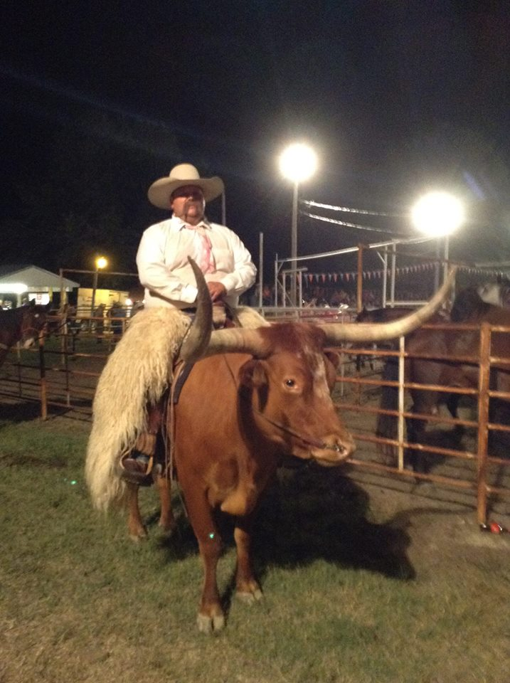"""Cody McGee rides his Longhorn steer named Albert in rodeo grand entries as part of """"Cody's Roundup,"""" a contract act at rodeos throughout the country."""