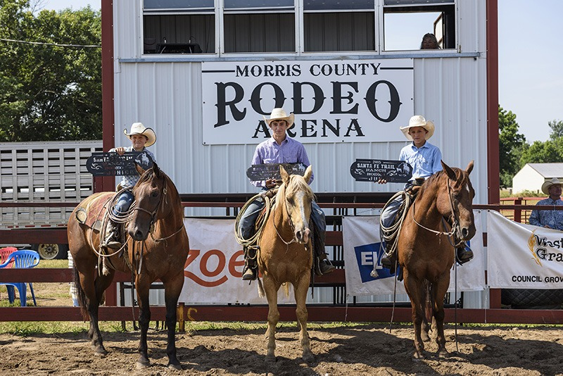 First place team in the Junior Ranch Rodeo, for cowboys and cowgirls 13 and under, in conjunction with the Working Ranch Cowboys Association competition at Council Grove went to the Diamond E Ranch of Redfield represented by brothers Bryce, Colt and Trent Eck. (Photo by Brian Schoenfish.)