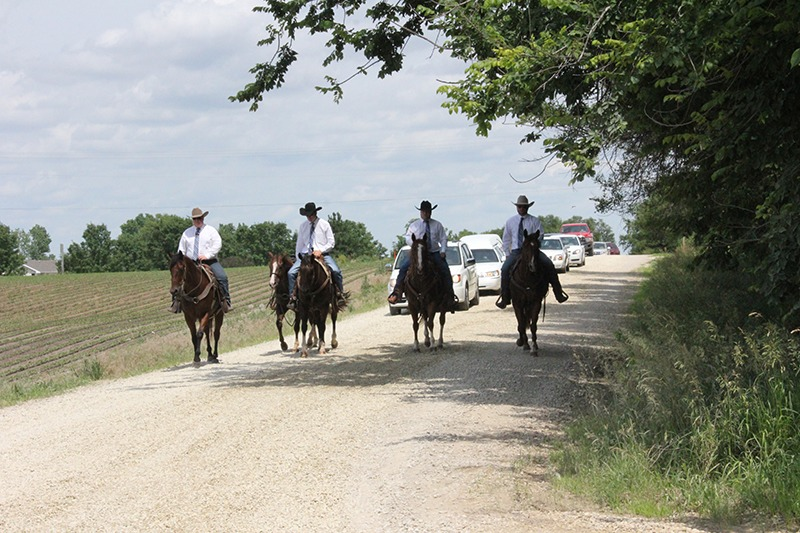 Grandsons Drew James, Jamie Stover, Brady James and Alex James lead Bill James rider less horse ahead of the hearse into St. Joseph Cemetery, Abilene, for James' graveside services.