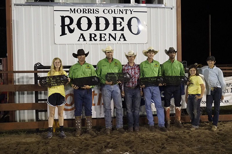 Lonesome Pine Ranch of Cedar Point in Chase County collected first place team honors in the 29th annual Working Ranch Cowboys Association Ranch Rodeo sponsored by the Morris County Youth Rodeo Association Fourth of July weekend at Council Grove. Friends and family posed with the ranch team composed of Bud Higgs, Frank Higgs, Makenzie Higgs, Troy Higgs, Travis Duncan and Chris Potter. (Photo by Bruce Hogle.)