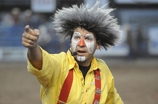 The Wildman look is actually most fitting for professional rodeo bullfighter-barrel man-clown-funnyman  as five-foot-ten, 180-pound, almost 39-years-old, red-nosed  Andy Burelle will be all decked out in yellow shorts, baggies with greasepaint in traditional big white speckled eyes and large white marked chin at the Linn County Fair Rodeo, Mound City, Kansas, August 7-8.