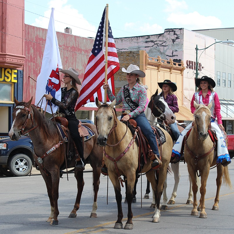 Pretty cowgirls add a spark of glamour to the rough and tough action of rodeo, and Eureka Rodeo Queen Shayla Lowry (right) and Eureka Rodeo Princess Cassidy Farmer (left front) will be at the Eureka Pro Rodeo, 8 p.m., August 14-15, and featured in the Saturday morning, Aug. 15, 10 o'clock, parade, along with other rodeo royalty. (Courtesy photo.)