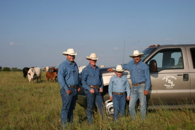 With their herd of registered seed stock in the background, Adam Spain, Kyle Gibb, Wyatt Reyer and Kim Reyer are in a partnership bull production business called Flint Hills Genetics at Strong City. The family business is co-sponsoring the sixth annual Flint Hills Bull Blowout bull riding competition Saturday evening, Sept. 12, at Strong City, and will have a number of bulls raised by their operation in the evening's performance.