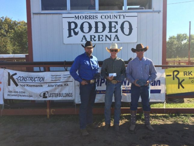 The Lonesome Pine Ranch from Cedar Point won the Fall Invitational Ranch Rodeo hosted by the Morris County Youth Rodeo Association at Council Grove. Travis Duncan, Troy Higgs and Bud Higgs are shown with their awards, while Chris Potter was the fourth member of the team. (Photo by Lisa Wainwright.)