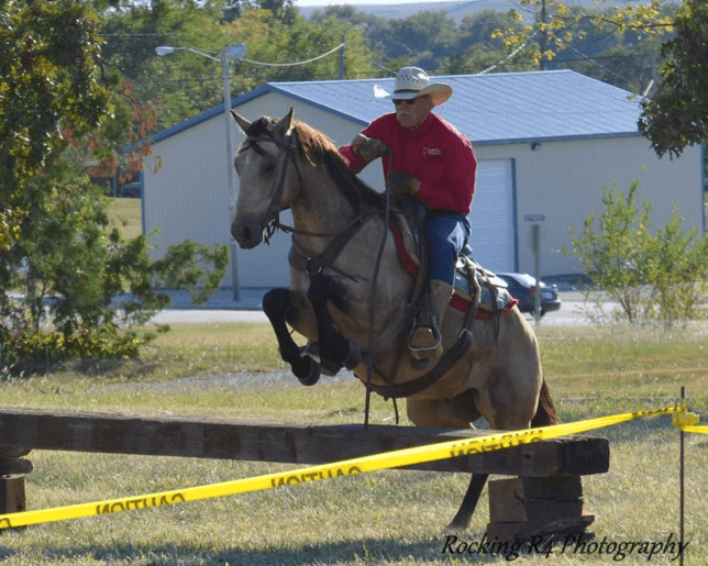 Entrepreneur in most all endeavors equine, Rex Buchman of Burdick helped in organizing the Ultimate Horseman's Challenge Association and his shown riding Hollywood Bear Cat, aka Oso, over a jump obstacle in a competition sponsored by that group this year at Strong City.
