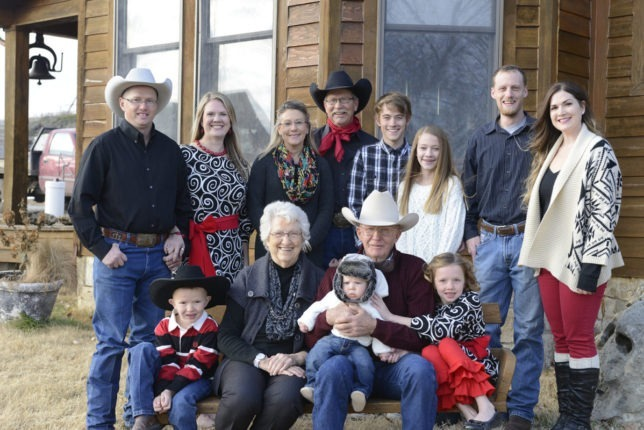 "Heritage in real cowboy country, the Flint Hills of Kansas, Rex Buchman of Burdick gathered some of his immediate family for this picture taking time. His deciphered description: ""(back row left to right) Justin Norsworthy, son-in-law; Darcy Norsworthy, daughter; Teresa Buchman, wife;  Rex Buchman, the cowboy himself; Jesse Andersen, stepson; Kali Andersen, stepdaughter; Steven Burlbaw, son-in-law; Hannah Burlbaw, daughter;  Dana Buchman  another daughter not in picture; (bottom row left to right) Eli Norsworthy, grandson; Mary Buchman, mother; Colt Burlbaw, grandson; Burton Buchman, dad; and Holly Norsworthy, granddaughter."