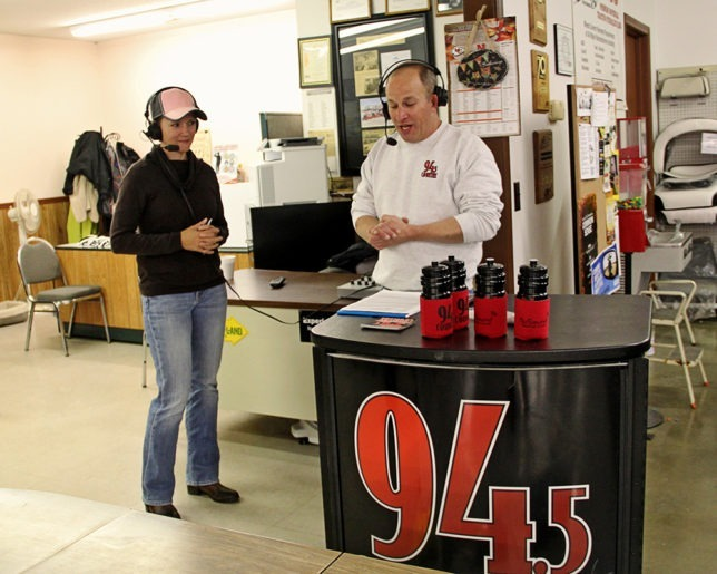 Lt. Col. Candy Smith, Platte City, Missouri, is interviewed by Jim Daniels live on The BIG 94.5 Country following her being awarded a new Mahindra XTV at Heinen Repair Service, Valley Falls, as winner of the Mahindra Tribute To The Brave Giveaway. (Photo courtesy of Lizzie Esparza, LE Photography.)