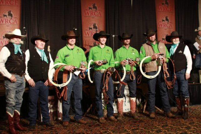 The Lonesome Pine Ranch from Cedar Point topped the wild cow milking event en route to winning the World Championship Ranch Rodeo at Amarillo, Texas. Shown with Working Ranch Cowboys Association officials and a portion of their championship hardware and loot are the Flint Hills of Kansas ranch team: captain Bud Higgs, Troy Higgs, Chris Potter and Travis Duncan. (Photo courtesy of the Working Ranch Cowboys Association.)