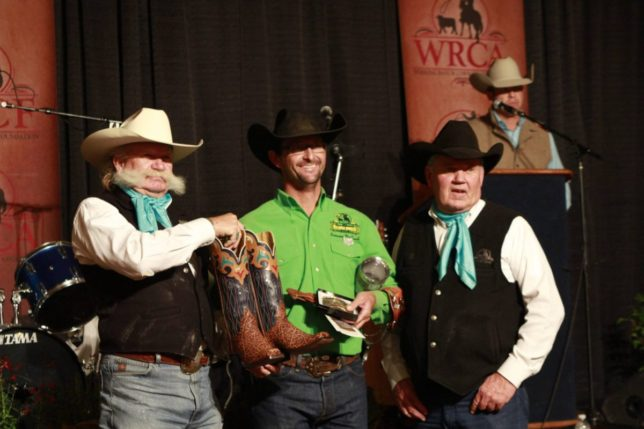 With officials of the Working Ranch Cowboys Association, the Lonesome Pine Ranch team from Cedar Point in Chase County all matched up in green shirts collected honors as winner out of 23 teams at the World Championship Ranch Rodeo in Amarillo, Texas. They're Bud Higgs, Chris Potter, Troy Higgs, Makenzie Higgs, Frank Higgs (his green shirt was in the washing machine) and Travis Duncan. (Photo courtesy of the Working Ranch Cowboys Association.)