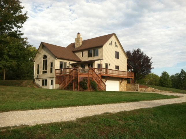 It's a most picturesque, two-level, post-and-beam, timber frame home Brad and Lila Carter live in at their farm near Paola.