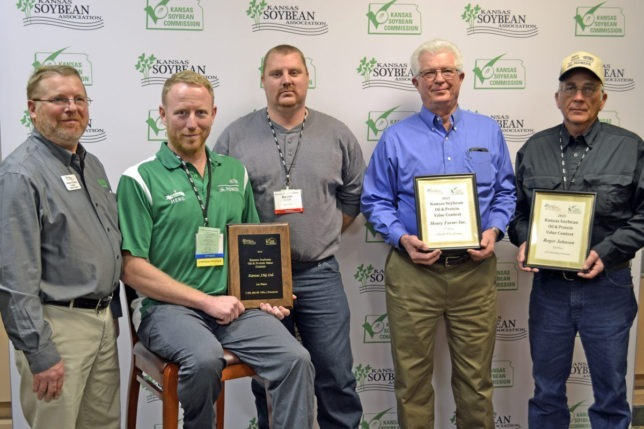Kansas Soybean Oil and Protein Value Contest winners were recognized at the Kansas Soybean Expo in Topeka. Left, Raylen Phelon, Melvern, president of the Kansas Soybean Association, presented awards to Mark Pettijohn and Dustin Conrad, Kansas JAG, Ltd., Salina County, first; Bob Henry, Henry Farms, Inc., Brown County, second; and Roger Johnson, Sheridan County, third. (Photo from the Kansas Soybean Commission.)
