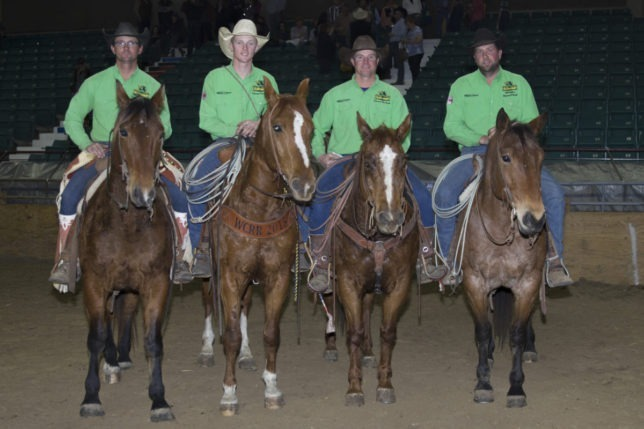 First place in the Saturday night ranch rodeo during the recent EquiFest of Kansas at Topeka went to the Lonesome Pine Ranch of Cedar Point. Team members include Chris Potter, Troy Higgs, Bud Higgs and Travis Duncan, who won the Top Horse Award at that performance. (Photo by Mindy Sue Andres.)
