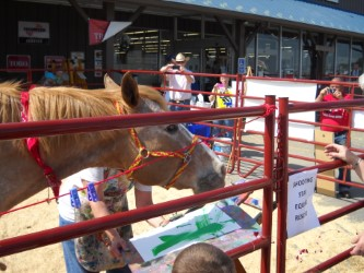Horses can paint, too, as proven by Duni from the Shooting Star Equine Rescue who'll be demonstrating his skills during the Breyer Fun Day Saturday at Bluestem Farm & Ranch Supply, Emporia.