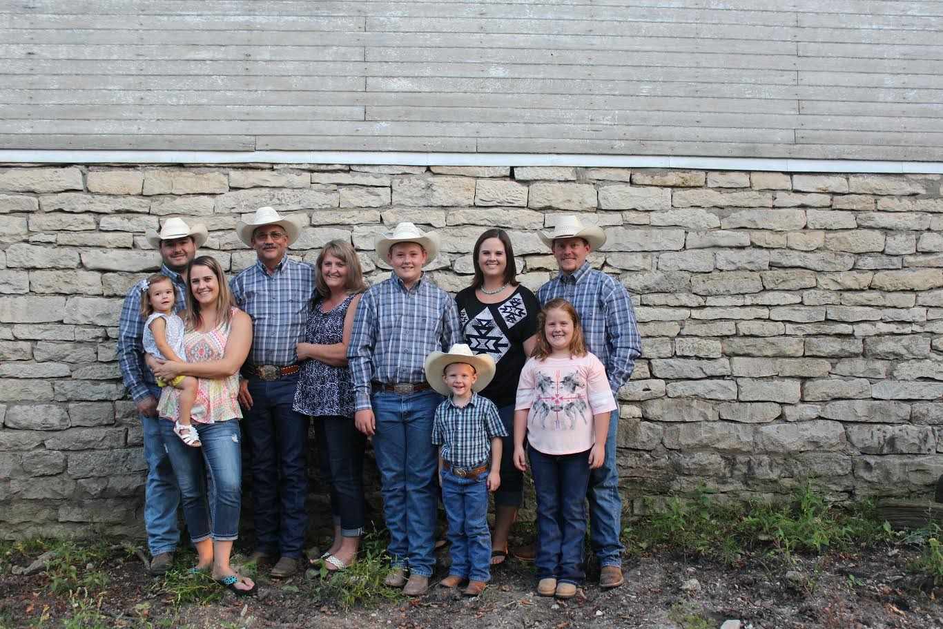 Flint Hills Genetics is a family bucking bull breeding operation at Strong City. The partners include (left to right) Adam, Kelsey and Lakin Spain; Kim, Lana and Wyatt Reyer; and Jenna, Tate, Karlie and Kyle Gibb.