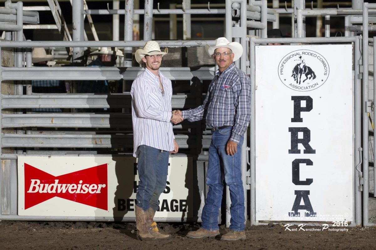 Ty Boor, Medicine Lodge, was awarded a $2,056 winner's check and Flint Hills Bull Blowout trophy belt buckle given by Brad Miller of Jim's Cowboy Shop at Emporia, and presented by Kim Reyer of Reyer's Country Store and Flint Hills Genetics bucking bull breeding program.