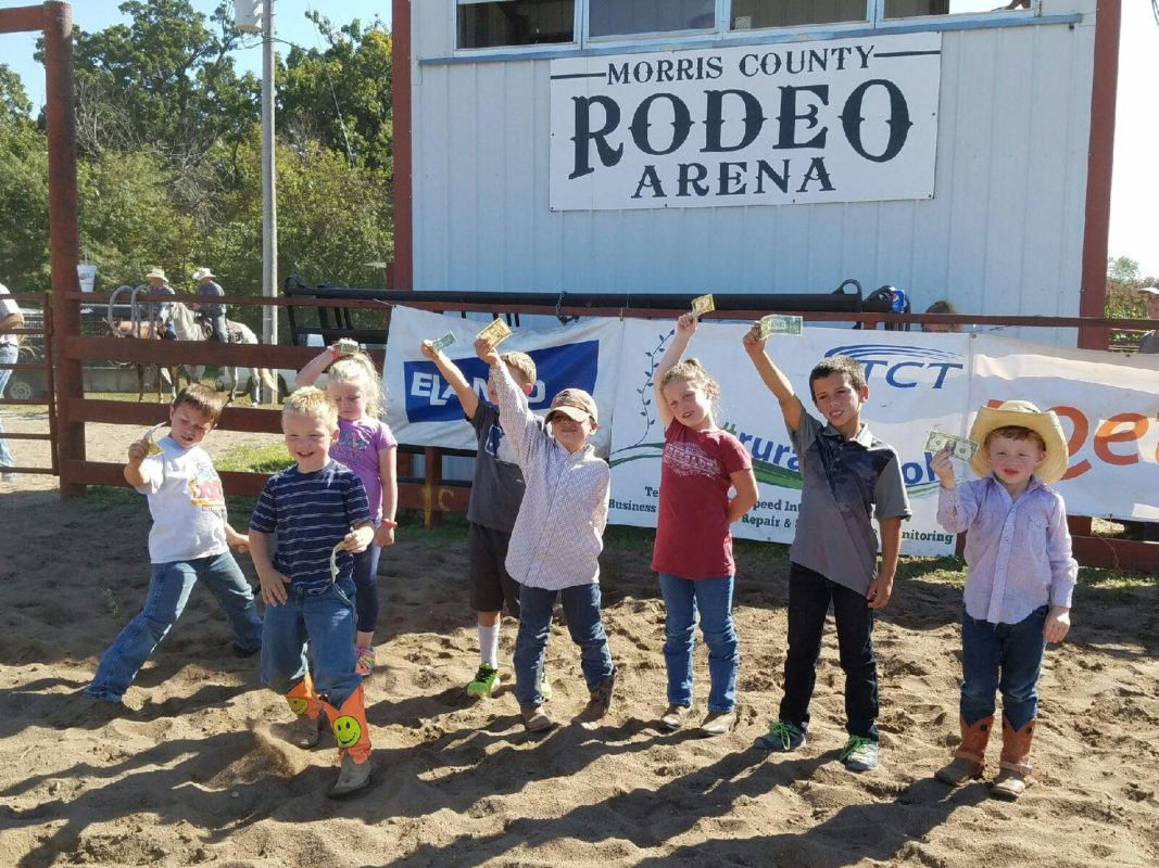 It's impossible to keep a little wild bunch calm as eight cowboys and cowgirls flashed their greenbacks received as prizes for riding in the Mutton Busting during the Morris County Invitational Ranch Rodeo at Council Grove.