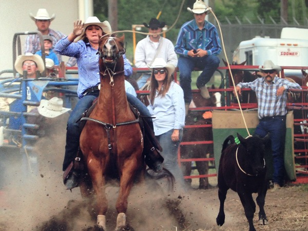 At the recent K-State Rodeo in Manhattan, Shelby Leonhard, 20, Oskaloosa, was the all-around women's award recipient winning the goat tying, and competing successfully also in barrel racing and breakaway roping, showing her form in that event here.