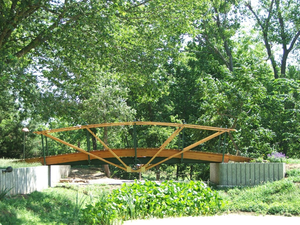 Biggest final project for artistic woodworker Bud Dugan, Alta Vista, was this walking bridge over the pond in his yard. The bridge has never seen any water under it, but it was another dream Bud had, and he made sure it was completed before his passing.