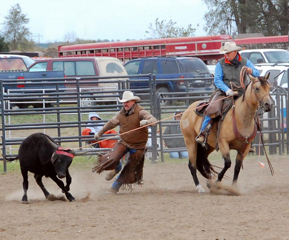 Denny Ashcraft (mounted) and Luke Kennedy are in action last year at a rodeo sponsored by the Jackson County Fair Association. The fourth annual Jackson County Rodeo is Friday and Saturday, July 25 and 26, at the Northeast Kansas Heritage Complex south of Holton on Highway 75.