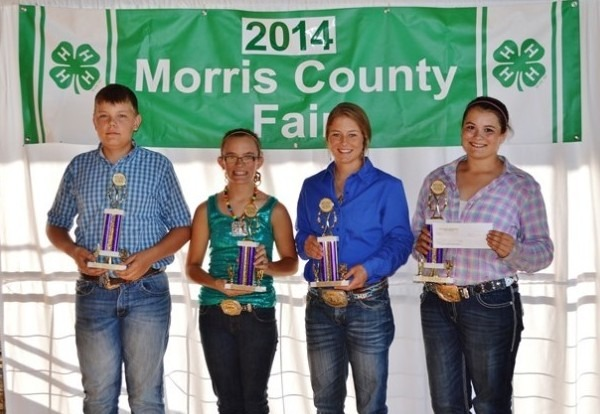 Winners in the round-robin showmanship competition at the Morris County Fair in Council Grove included Wyatt Buchman, junior champion; Makenzie Downes, junior reserve champion; Michaela Peterson, senior reserve champion; and Sarah Loomis, senior champion. Photo by Shilo King
