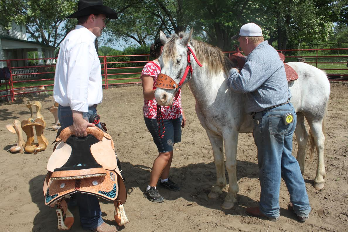 A proper fitting saddle is critical to optimum performance of a horse and its rider. Russ Brown of The R Bar B, Topeka, is a perfection expert in making correct measurements for custom saddles built by the R Bar B Saddlery.