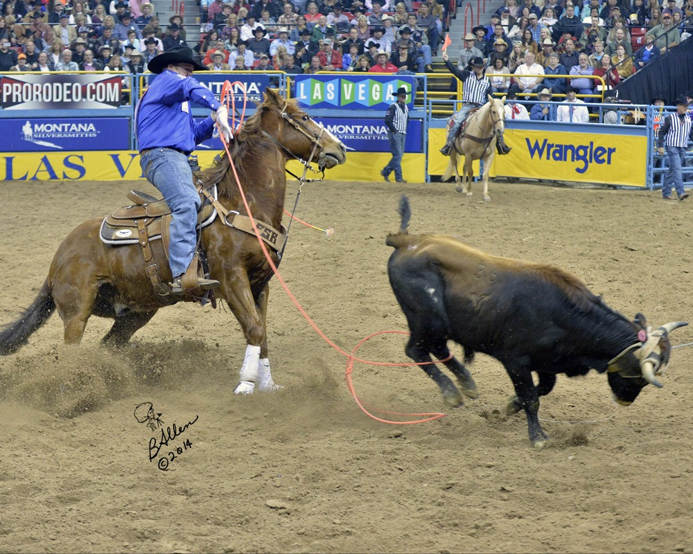 Jake Long, Coffeyville, Kansas, shows his championship heeling form from the back of his sorrel Quarter Horse Colonel as he moved up from ninth to third in the world standings of the Professional Rodeo Cowboys Association after placing in six go-rounds at the National Finals Rodeo in Las Vegas. With heeler Coleman Proctor, Pryor, Oklahoma, lifelong friend since a family movie was made of them roping a practice dummy during a rodeo 25 years ago, the team placed fourth in the average at the finals' team roping. (Photo courtesy of Brenda Allen, arp@allensrodeophotos.com.)