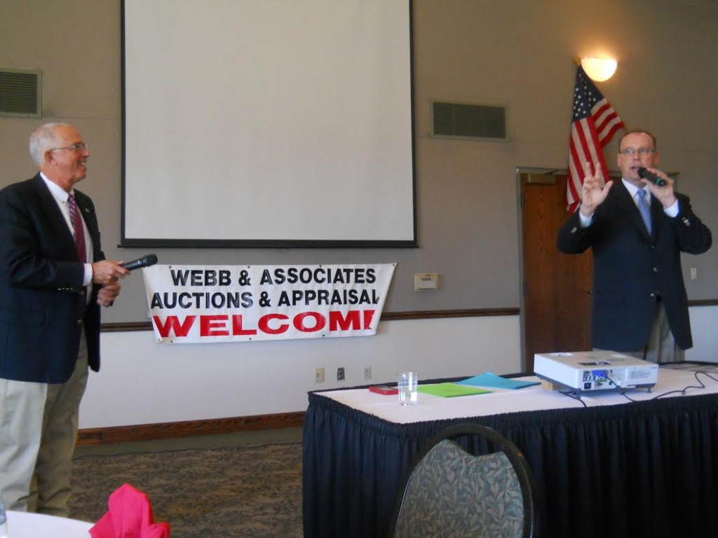Col. Dave Webb served as announcer and bid taker, as Col. Kevin Borger representing Webb & Associates Auctioneers and Appraisers of Stilwell conducted two successful Johnson County real estate auctions at Overland Park.
