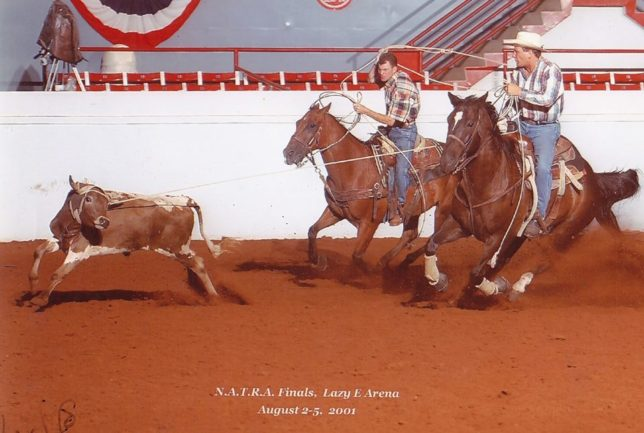 DK Hewett, Broken Arrow, Oklahoma, heads a steer for Jim Peters to win part of the average at the North American Team Roping Association Finals in 2001.