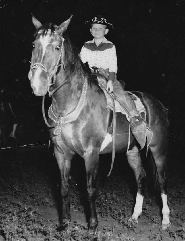 With a hat from the American Royal and a mom-made feed sack shirt, DK Hewett rode Pat in their first horse show at six