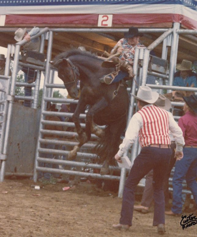 DK Hewett, Broken Arrow, Oklahoma, won a go-round in the saddlebronc riding at the 1975 Southwest Cowboys Association Finals Rodeo on Floyd Rumford's SCA Bucking Horse of the Year, Jake.