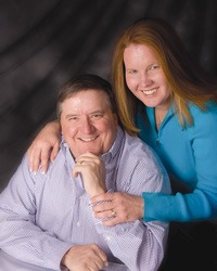 In a formal portrait, Ron and Christy Ratliff of Garnett are recognized worldwide as owners of Ratliff Jerseys, producing and merchandizing highest quality, heaviest milking cows of the breed.