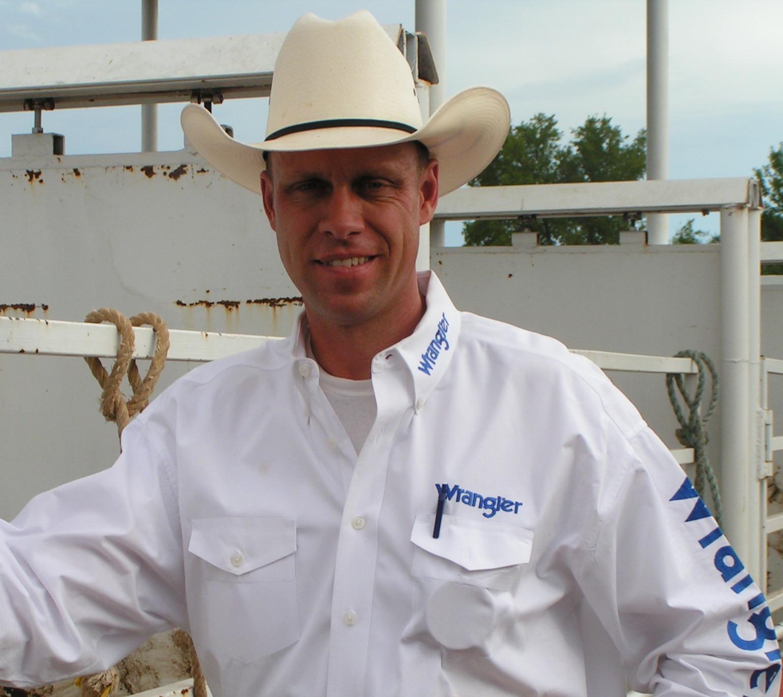 Troy Goodridge of Fort Scott, former champion professional bull rider, announced the Flint Hills Bull Blowout in Strong City Saturday night.